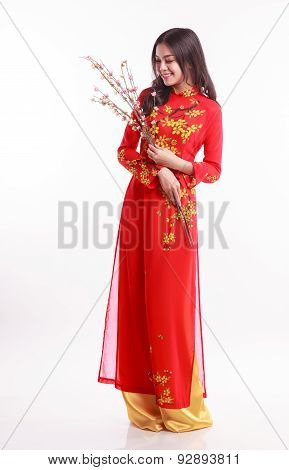 Beautiful Vietnamese Woman With Red Ao Dai Holding Cherry Blossom For Celebrate Lunar New Year On Wh