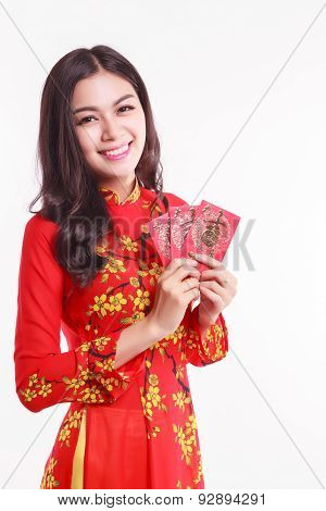 Beautiful Vietnamese Woman With Ao Dai Holding Lucky Red Packet For Celebrate Lunar New Year On Whit