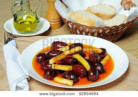 Mini Chorizo Sausages with chips.