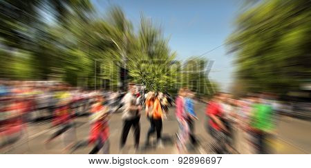 Abstract Background. Pedestrians Walking - Rush Hour I.  Radial Zoom Blur Effect Defocusing Filter A