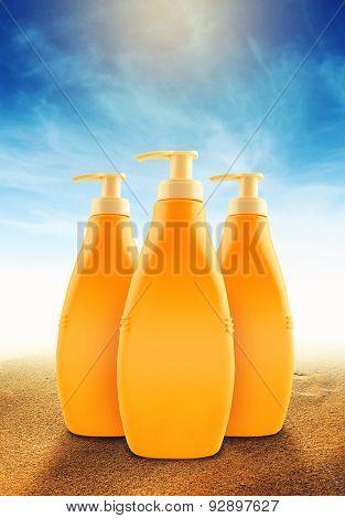 Suntan Lotion Bottles On Sunny Beach