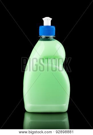 Green Plastic Bottle Over Black