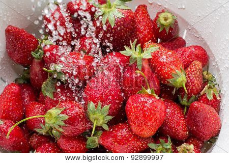 Freezed Drops Over The Ripe Strawberry Rinsed With Water