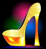 stock photo of platform shoes  - dark festive background and the golden ladys shoe - JPG