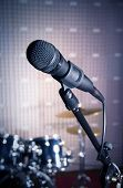 stock photo of stand up  - Modern microphone on a stand recording studio microphone DSLR picture sound wall microphone stand drum set mesh wire close - JPG