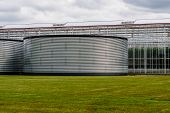 pic of greenhouse  - large water tanks for the storage of water for greenhouses - JPG