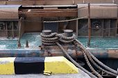 stock photo of bollard  - Bollard with mooring line old ship cable - JPG