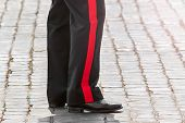 stock photo of policeman  - detail of italian policeman on the road - JPG