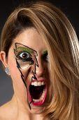 pic of nose ring  - Closeup of Girl Screaming and wearing Lightning Makeup - JPG