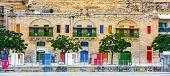 pic of windows doors  - colorful doors and windows in Valletta embankment street in Malta - JPG