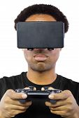 stock photo of controller  - Black male wearing a virtual reality headset and controller on white background - JPG