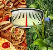 stock photo of scale  - Dieting choice weight scale with unhealthy junk food on one side and healthy fruit and vegetables on the other half as a fitness and nutrition eating decision symbol - JPG