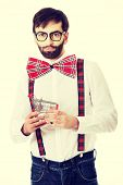 picture of suspenders  - Funny man wearing suspenders with small shopping basket - JPG