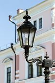stock photo of downspouts  - Beautiful lantern on a background of an old building on a sunny day - JPG