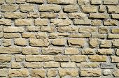 stock photo of tile cladding  - New stone cladding plates on the wall closeup - JPG
