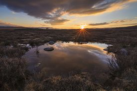stock photo of marshlands  - Marshland on the background of mountain scenery and the rain clouds - JPG