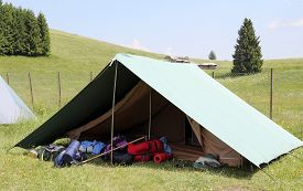 stock photo of boy scout  - One tent of a campsite of the boy scouts in the mountains in summer - JPG