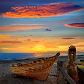 stock photo of boat  - Almeria Cabo de Gata beached boats in San Miguel beach of Spain - JPG