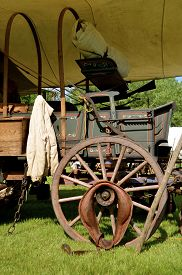pic of wagon  - The top has been removed from a covered wagon will of artifacts of the post Civil War era - JPG