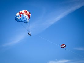 image of parasailing  - Parasailing on a sunny day in the Caribbean - JPG