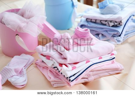 New baby clothes on bed
