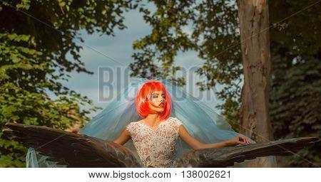 Bride With Orange Hair In Blue Veil