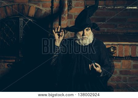 Old Wizard With Pendulum