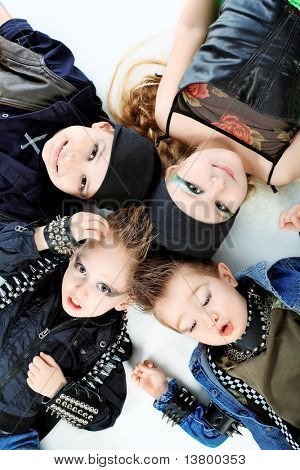 Group of children singing in heavy metal style. Shot in a studio. Isolated over white background.