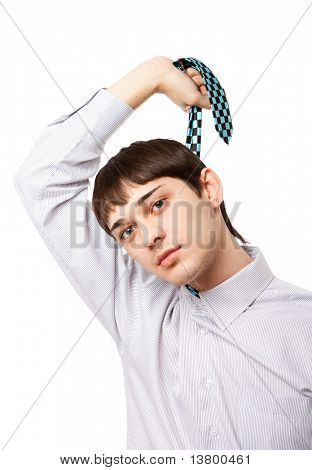 Young man holding his tie isolated on white bakground