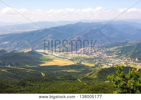 Beautiful view of the old town of Mtskheta from the Zedazeni mountain in Georgia. First capital of Georgia and a UNESCO World Heritage site.