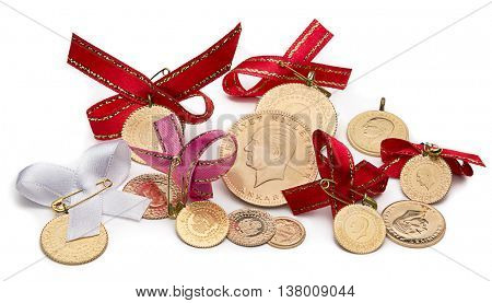 Variety of traditional Turkish gold coins isolated on white background.