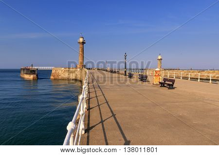 Whitby Pier on a beautiful sunny day North Yorkshire UK