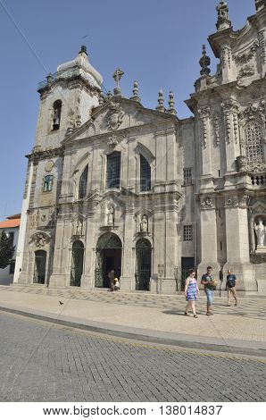 PORTO, PORTUGAL - AUGUST 10, 2016: People in front of the Carmelitas church just next to the Carmo church in Porto Portugal