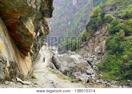 Mountain road along the river in Nepal, Himalayas, Annapurna Conservation Area