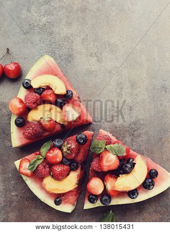 Delicious watermelon pizza with fruits and berries