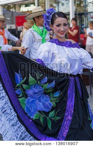 ROMANIA TIMISOARA - JULY 7 2016: Columbian dancer in traditional costume perform folk dance during