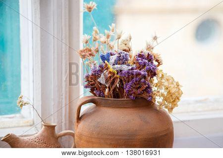 clay pot dry flower still life close up
