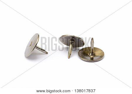 Ordered pile pushpins isolated on white background