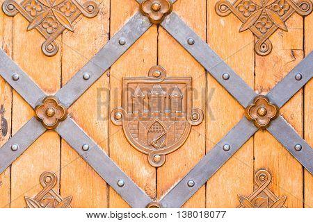 ancient door knocker on a wooden door