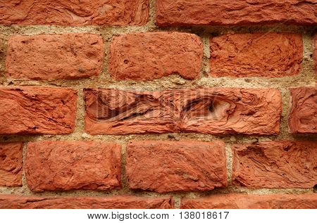 The texture of the bricks from clay.It degrades over time and under the action of the weather.