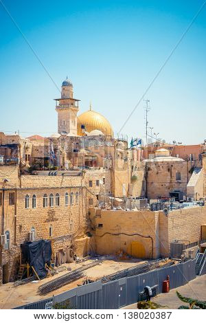 View of the Wailing Wall and on the gold-plated Dome Rock Al-Aqsa, Temple Mount, minaret, Jerusalem. Israel.