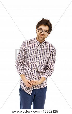 Crazy and funny laughing handsome young man in jeans, plaid shirt and glasses with messy hair. Isolated on white background.
