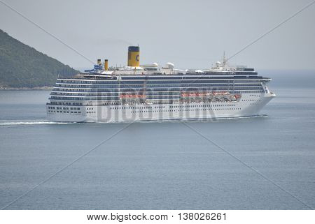 Herceg Novi, Montenegro - June 23, 2016: Costa Mediterranea cruise ship in Boka Bay, Montenegro. Costa Mediterranea is was constructed  in Helsinki, Finland.