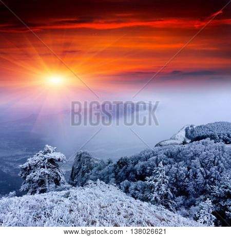 Nice winter landscape with sunset in mountains
