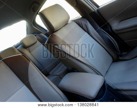 Vehicle safety. Headrests and safety belts inside car interior