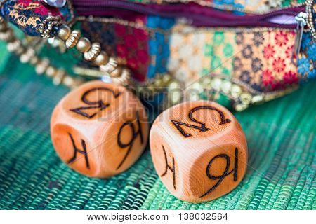 two wooden astrology cubes with zodiac signs