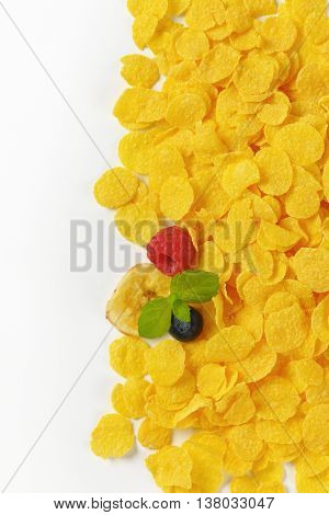 pile of corn flakes on white background