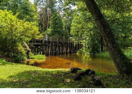 The picturesque Rospuda river old wooden bridge Poland
