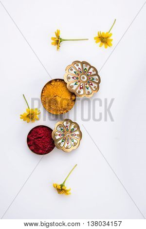 huldi kumkum with flowers, isolated over white background, indian tradition, women mark huldi kumkum on each other's forehed in Makar Sankranti hindu festival also known as huldi-kumkum occassion