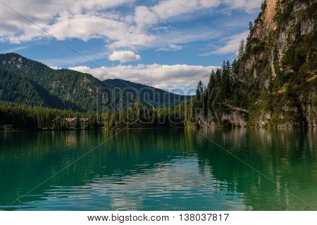 Amazing view of Lago di Braies with mountain forest on the background.